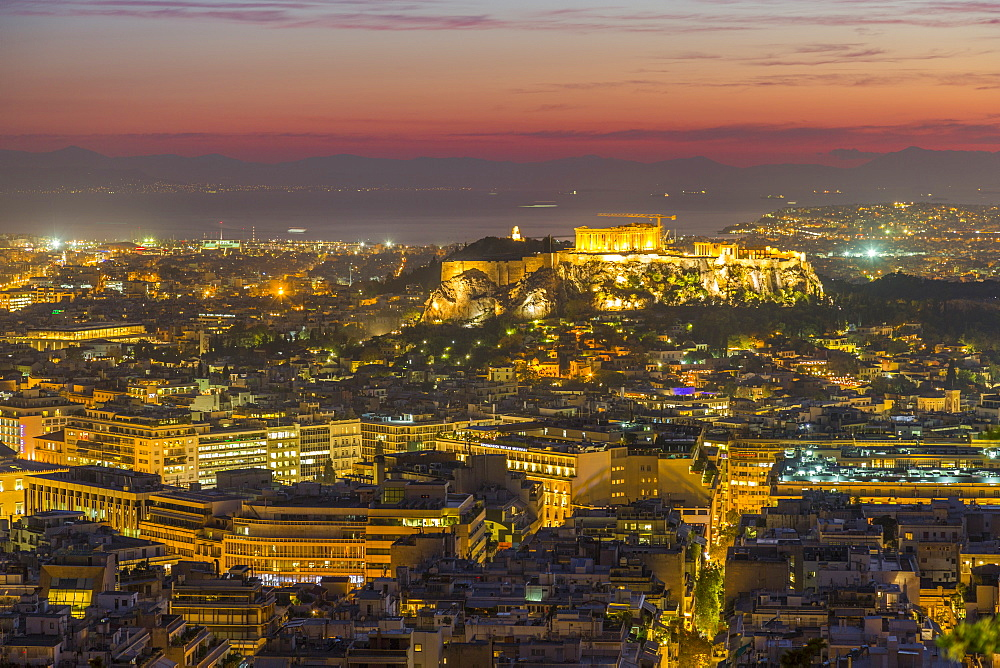 View of Athens and The Acropolis from Likavitos Hill and Aegean Sea visible on horizon dusk, Athens, Greece, Europe