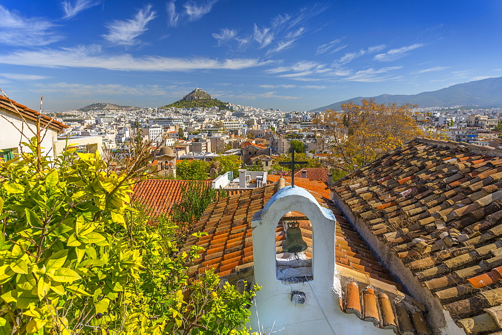 View of Athens and Likavitos Hill over the rooftops of the Plaka District, Athens, Greece, Europe