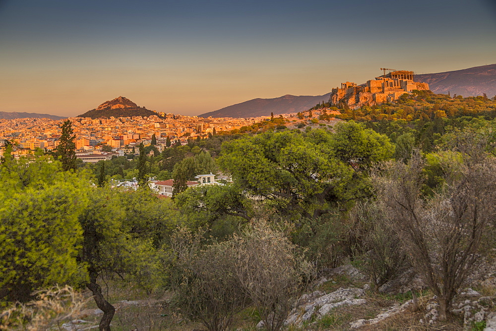 View of The Acropolis and Likavitos Hill at sunset from Filopappou Hill, Athens, Greece, Europe