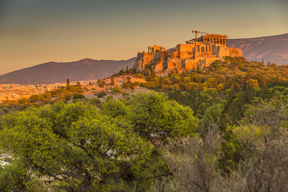 View of The Acropolis at sunset from Filopappou Hill, Athens, Greece, Europe