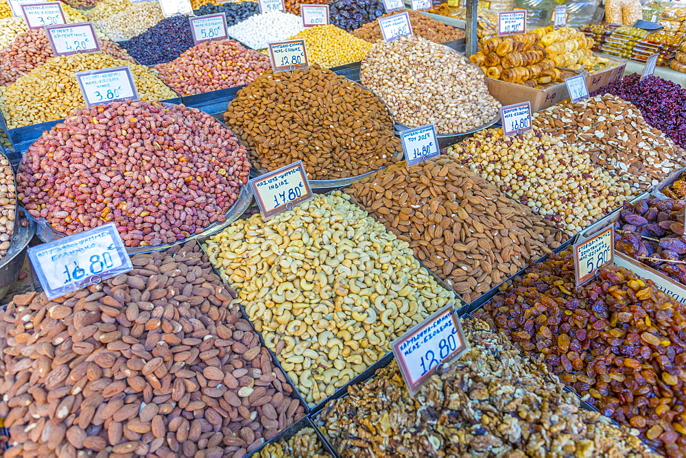 Nuts, dried fruits and raisens produce stall in Central Market, Monastiraki District, Athens, Greece, Europe