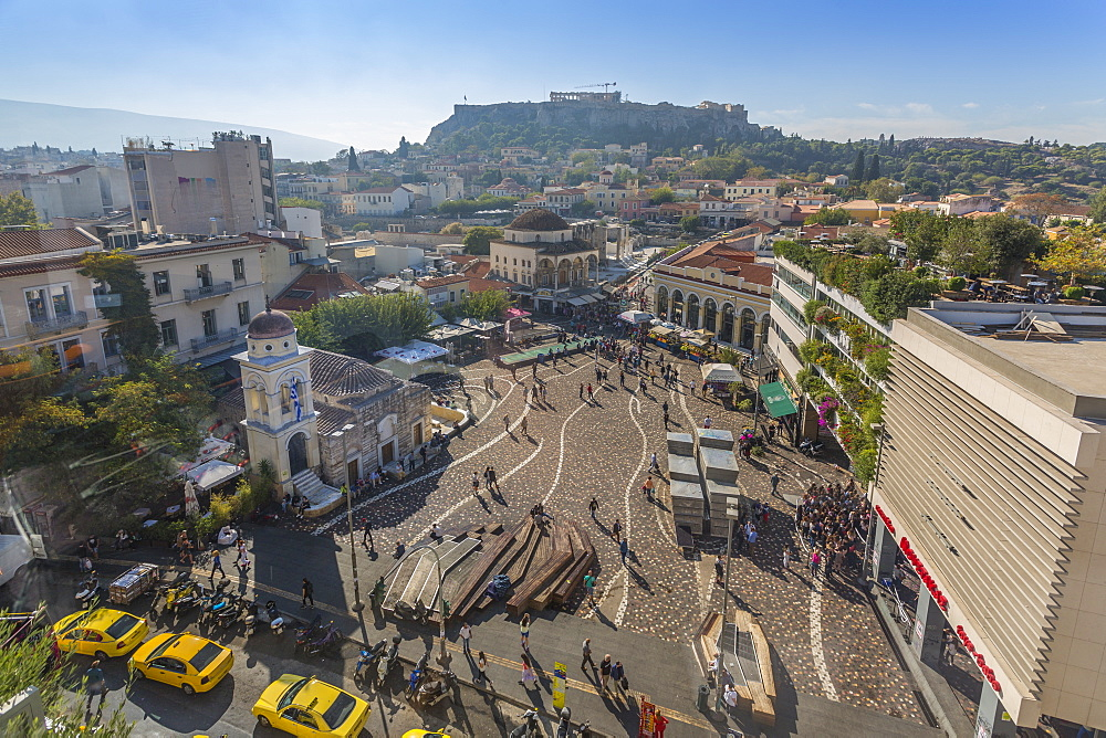 Elevated view of taxis, shoppers and Greek Orthodox Church in Monastiraki Square, Acropolis visible in background Monastiraki District, Athens, Greece, Europe
