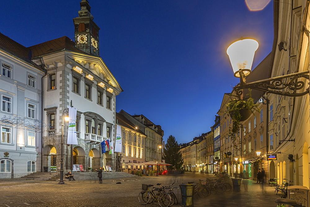 View of Town Hall and street scene at dusk, Ljubljana, Slovenia, Europe