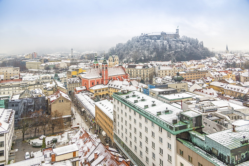 View of snow covered Ljubljana old town and Castle from The Skyscraper, Ljubljana, Slovenia, Europe
