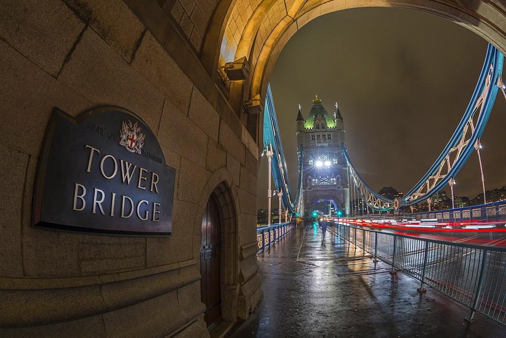 Fisheye view of traffic trail lights on Tower Bridge at night, Southwark, London, England, United Kingdom, Europe