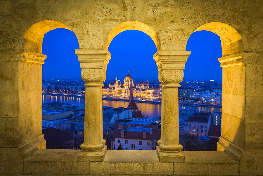 View of Parliament Building from Fisherman's Bastion at dusk, Buda Castle Hill, Budapest, Hungary, Europe