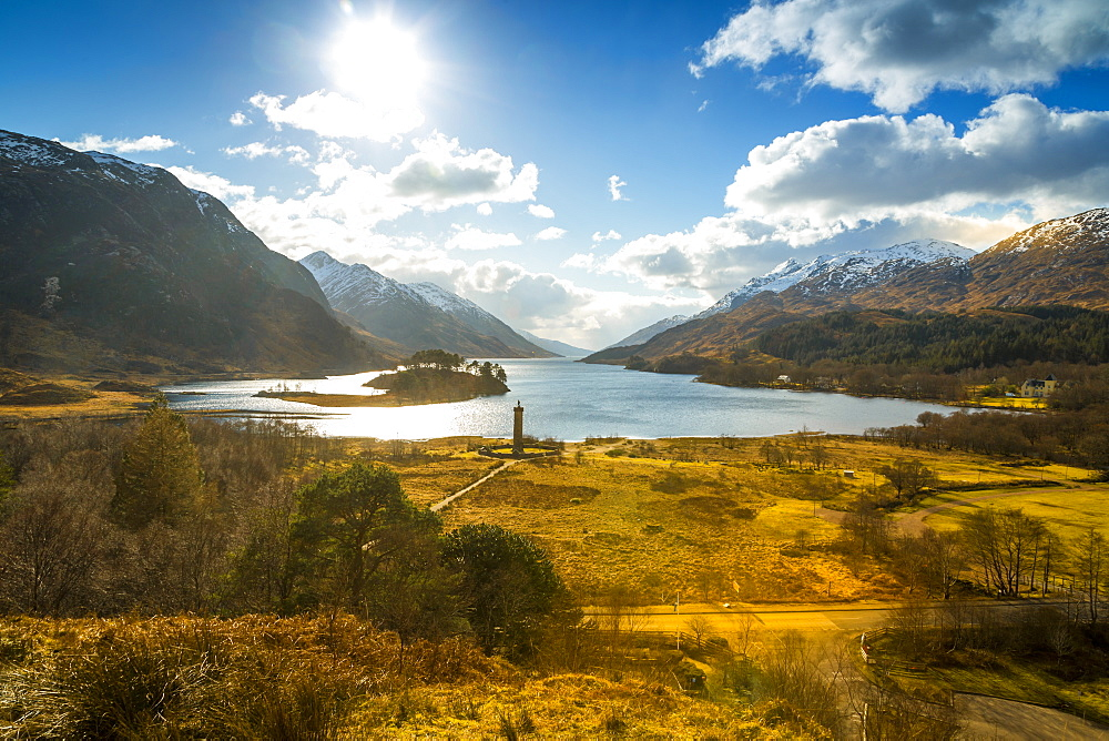 Sunshine and The Glenfinnan Monument beside Loch Shiel, Highlands, Scotland, United Kingdom, Europe