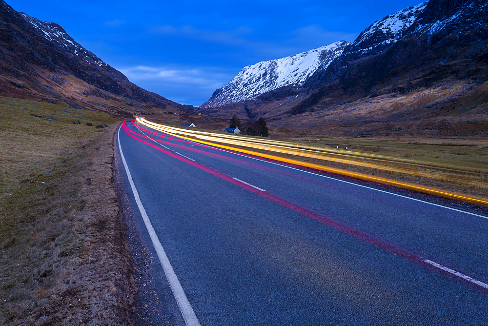 View of road through the Glencoe Valley at dusk, Glencoe, Highland Region, Scotland, United Kingdom, Europe