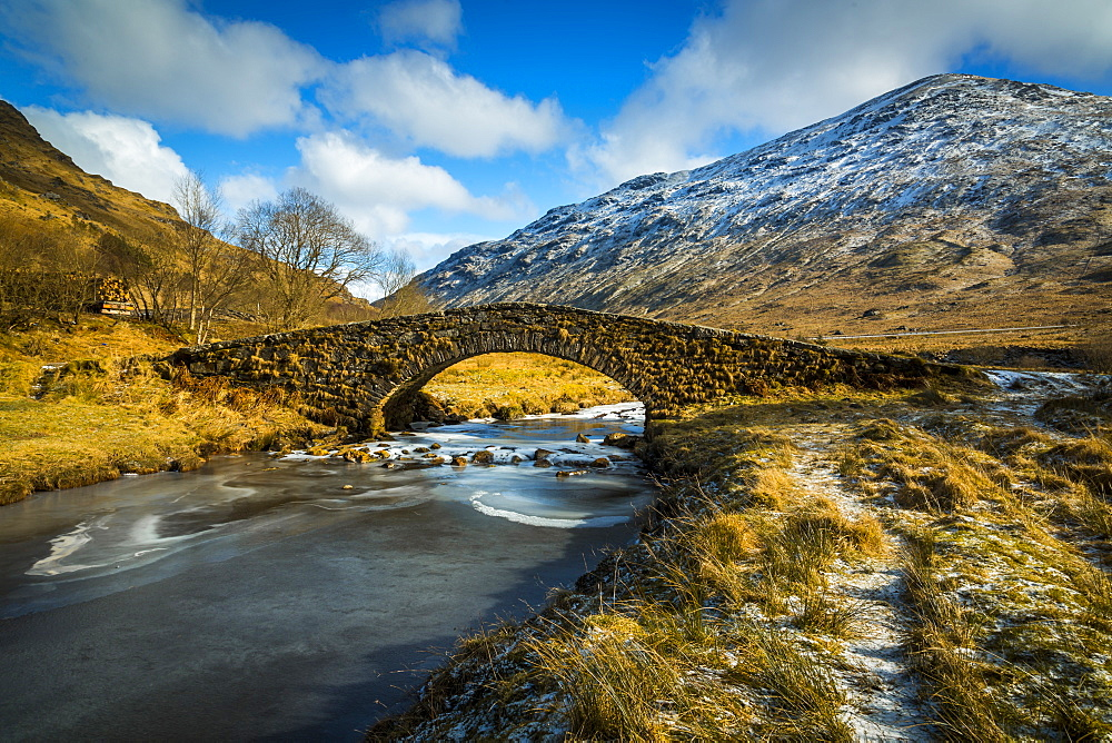 View of mountains and Cattle Bridge in winter, in the Argyll Forest and National Park, Highlands, Scotland, Europe