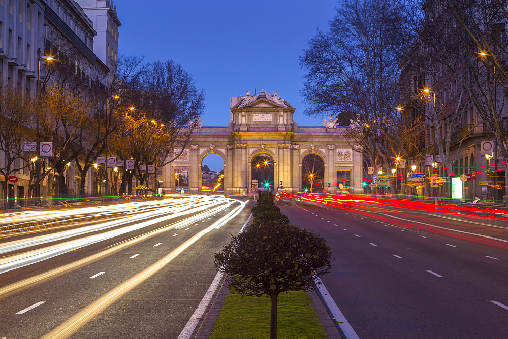 View of trail lights and Plaza de la Independencia at dusk, Madrid, Spain, Europe