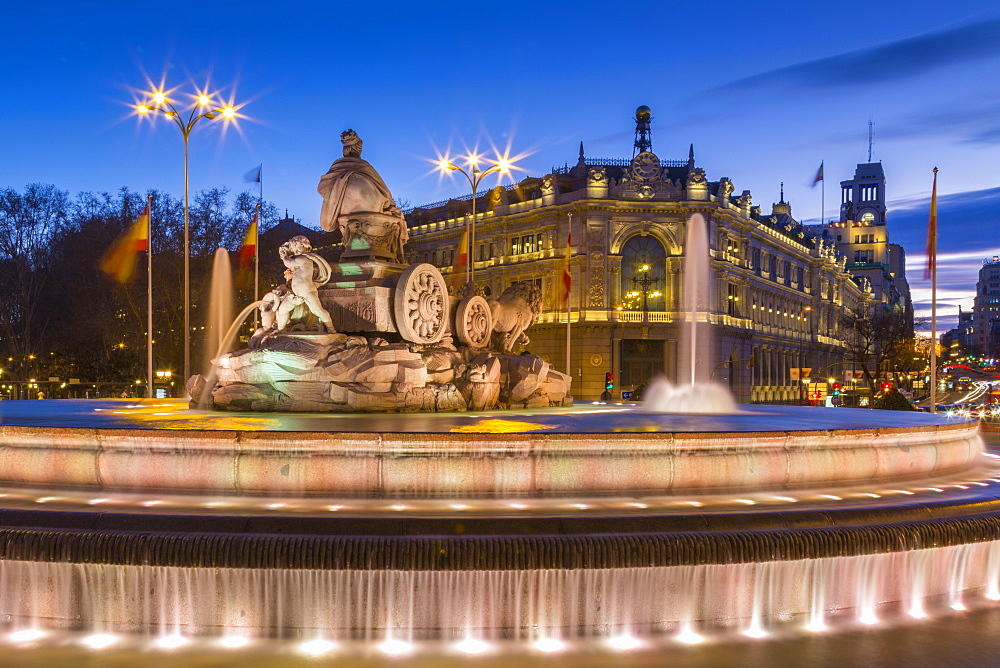 View of Cibeles Fountain in Plaza Cibeles and Calle de Alcala at dusk, Madrid, Spain, Europe