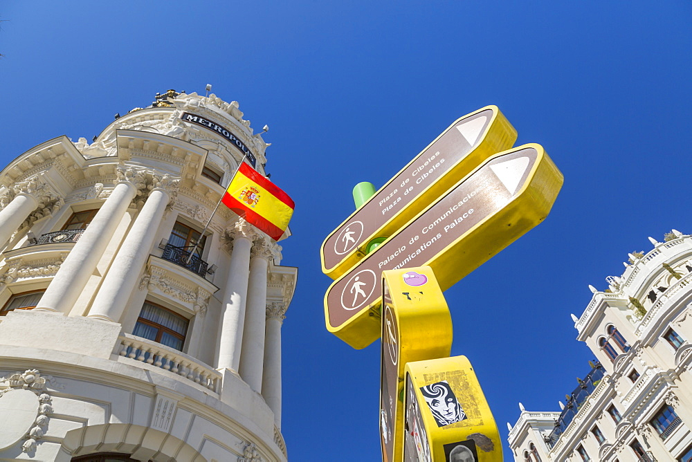 View of sign and Metropolis Building on Gran Via, Madrid, Spain, Europe