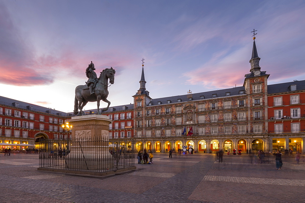 View of Philip lll statue and architecture in Calle Mayor at dusk, Madrid, Spain, Europe