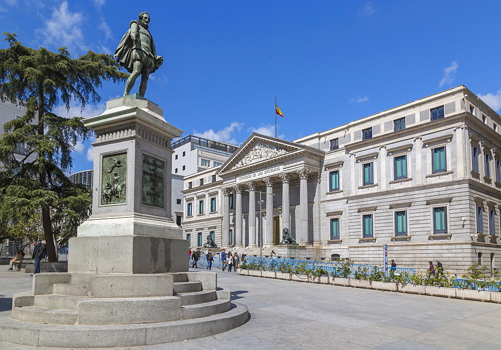 View of Michaeli de Gervantes statue and Congress in Plaza de las Cortes, Madrid, Spain, Europe