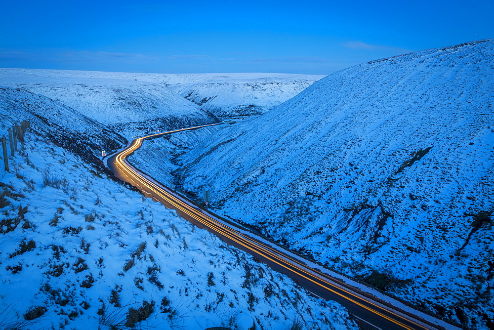 Winter landscape & trail lights on Snake Pass, Peak District National Park, Derbyshire, England, United Kingdom, Europe