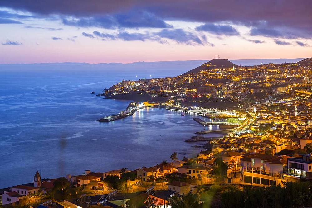 View of Funchal harbour and town at dusk, Funchal, Madeira, Portugal, Atlantic, Europe