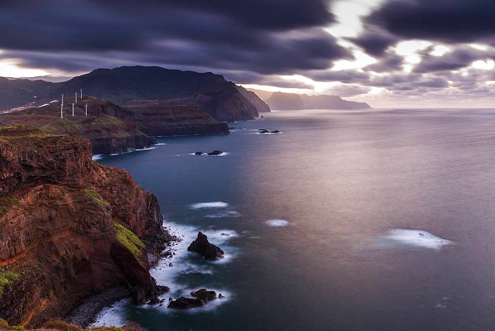 Rocky coast at the Ponta da Sao Lourenco and Spring flowers at sunset, Eastern tip of the island, Madeira, Portugal, Europe