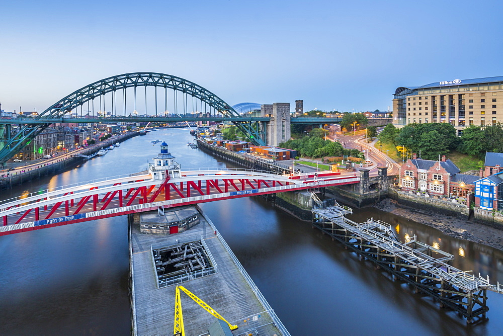 View of The Tyne Bridge, Swing Bridge and Tyne River at dusk, Newcastle-upon-Tyne, Tyne and Wear, England, United Kingdom, Europe