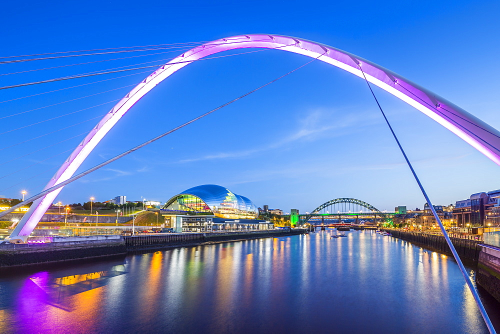 View of Tyne River and Gateshead Millennium Bridge at dusk, Newcastle-upon-Tyne, Tyne and Wear, England, United Kingdom, Europe