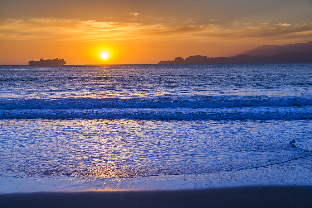 Sunset from Baker Beach overlooking Pacific Ocean at dusk, South Bay, San Francisco, California, United States of America, North America