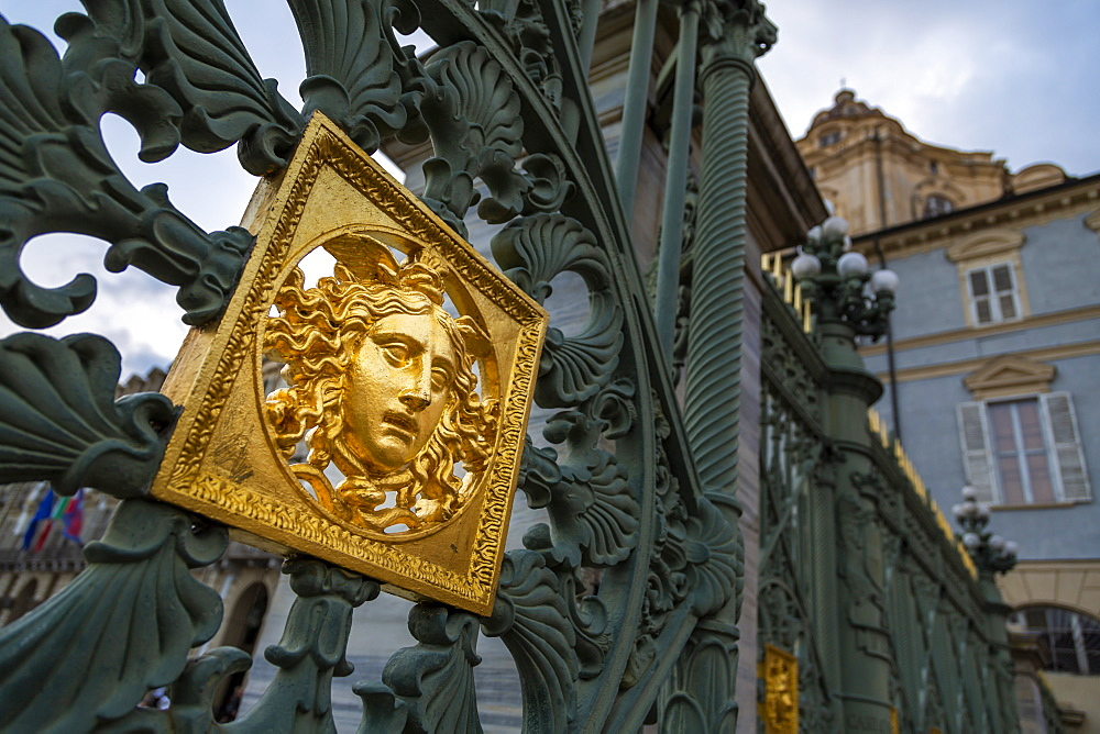 Gates of the Royal Palace of Turin (Palazzo Reale) embossed with a golden Medusa symbol, Turin, Piedmont, Italy, Europe