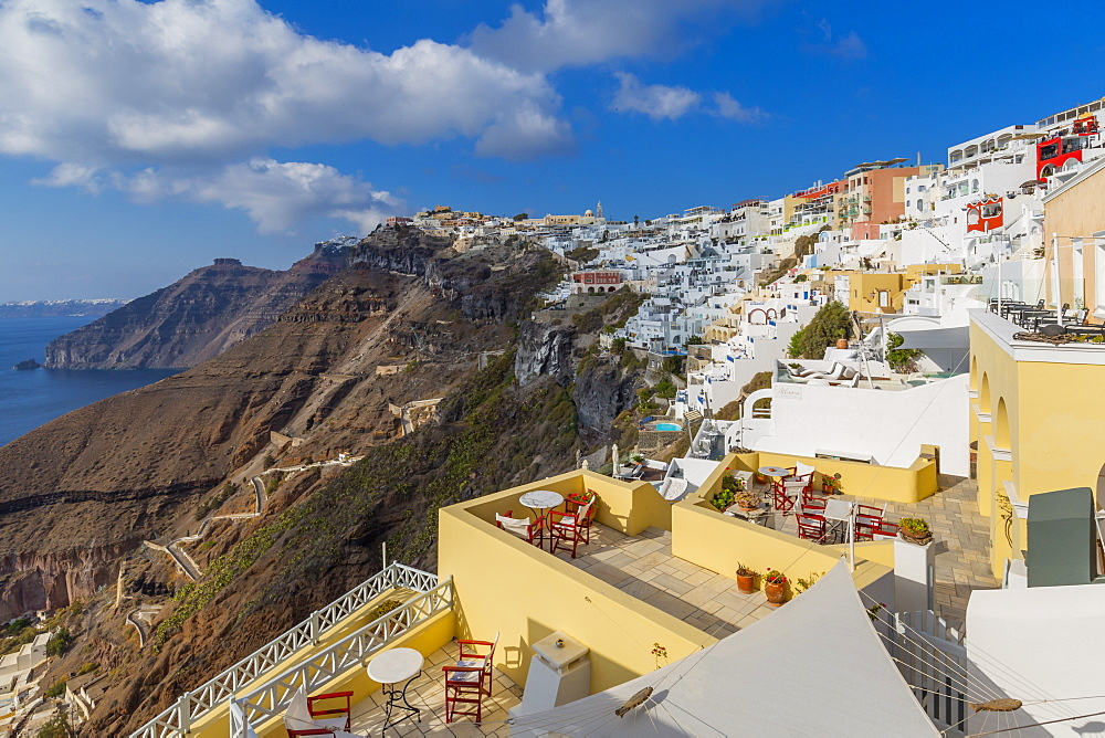 View of Fira white washed houses clinging to rocks, Firostefani, Santorini (Thira), Cyclades Islands, Greek Islands, Greece, Europe