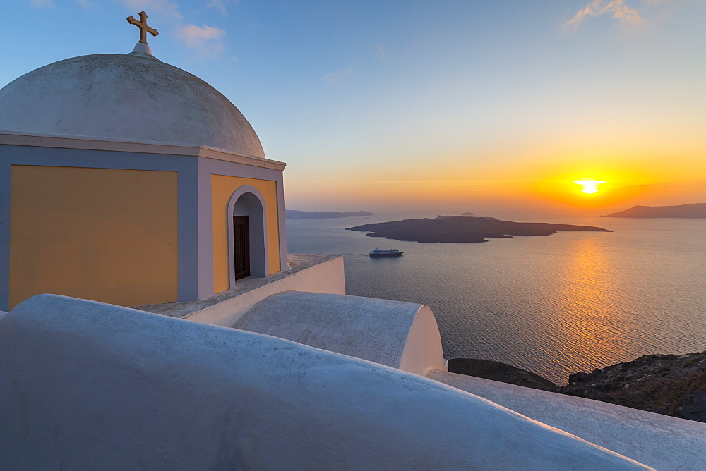 View of Greek Church of Saint Stylianos at sunset, Firostefani, Santorini (Thira), Cyclades Islands, Greek Islands, Greece, Europe