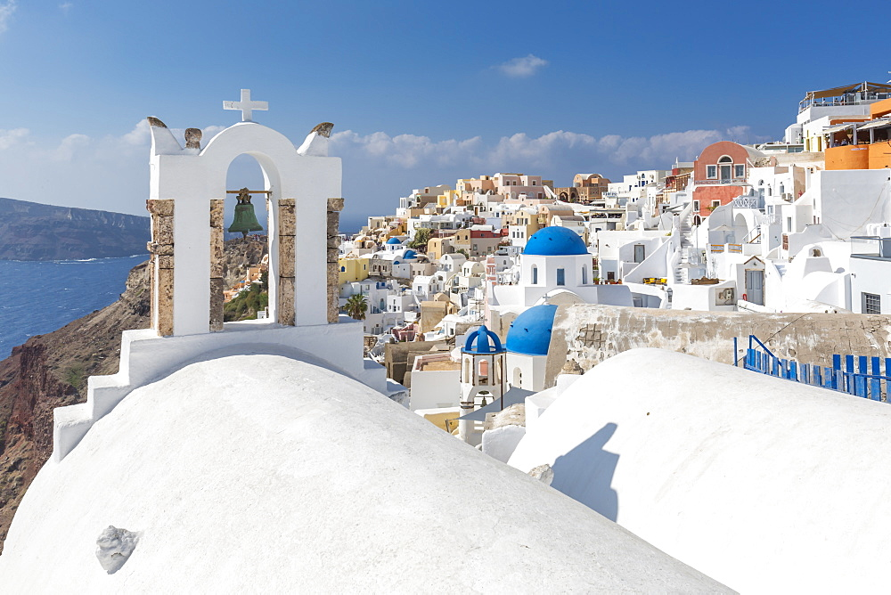 View of blue domed churches and Oia village, Santorini, Aegean Island, Cyclades, Aegean Islands, Greek Islands, Greece, Europe