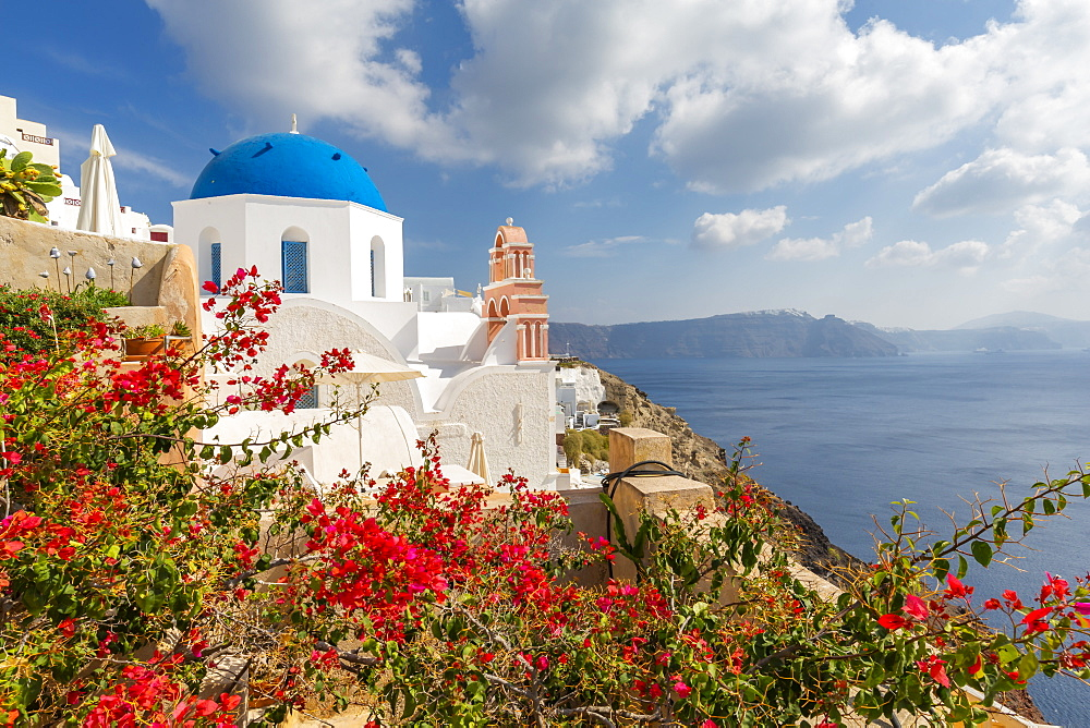 View of blue domed church and sea in Oia village, Santorini, Cyclades, Aegean Islands, Greek Islands, Greece, Europe