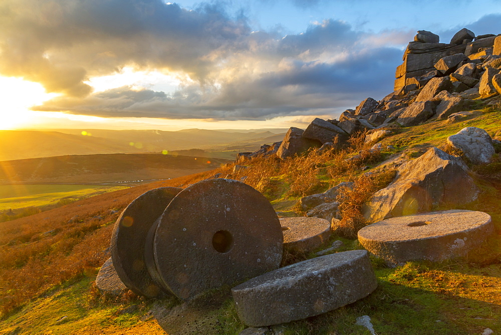View of sunset and old millstones at Curbar Edge during autumn, Derbyshire, Peak District National Park, England, United Kingdom, Europe
