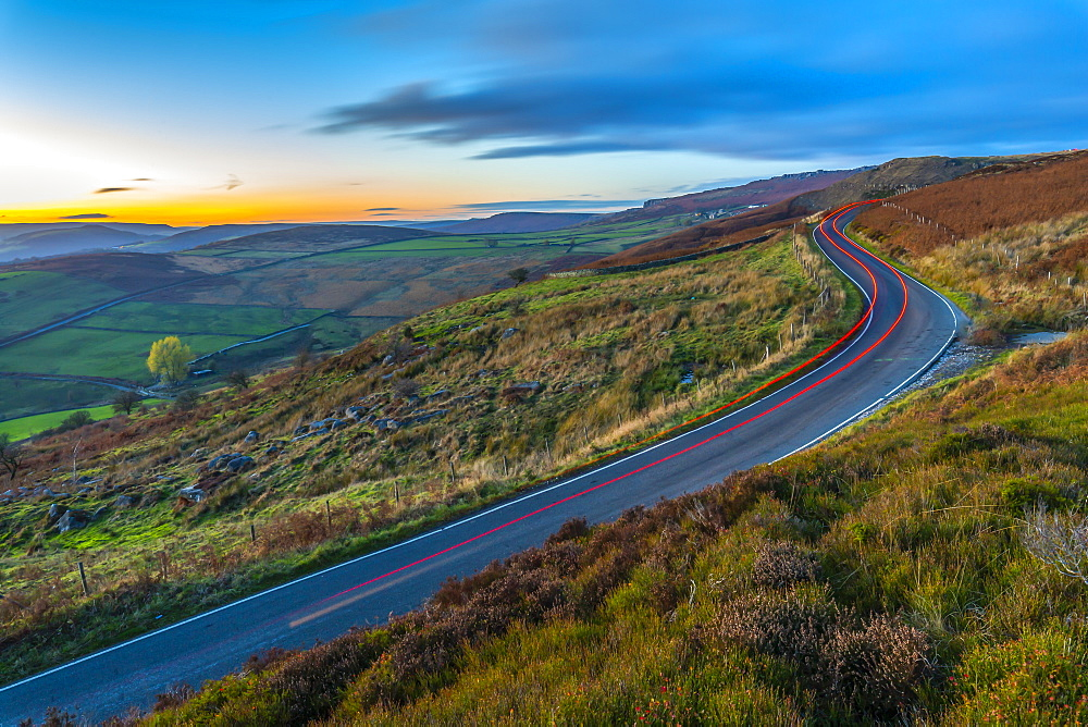 Car trail lights near Curbar Edge at dusk, Derbyshire, Peak District National Park, England, United Kingdom, Europe