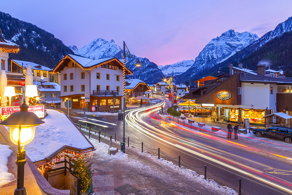 View of Canazei town centre at dusk in winter, Canazei, Val di Fassa, Trentino, Italy, Europe