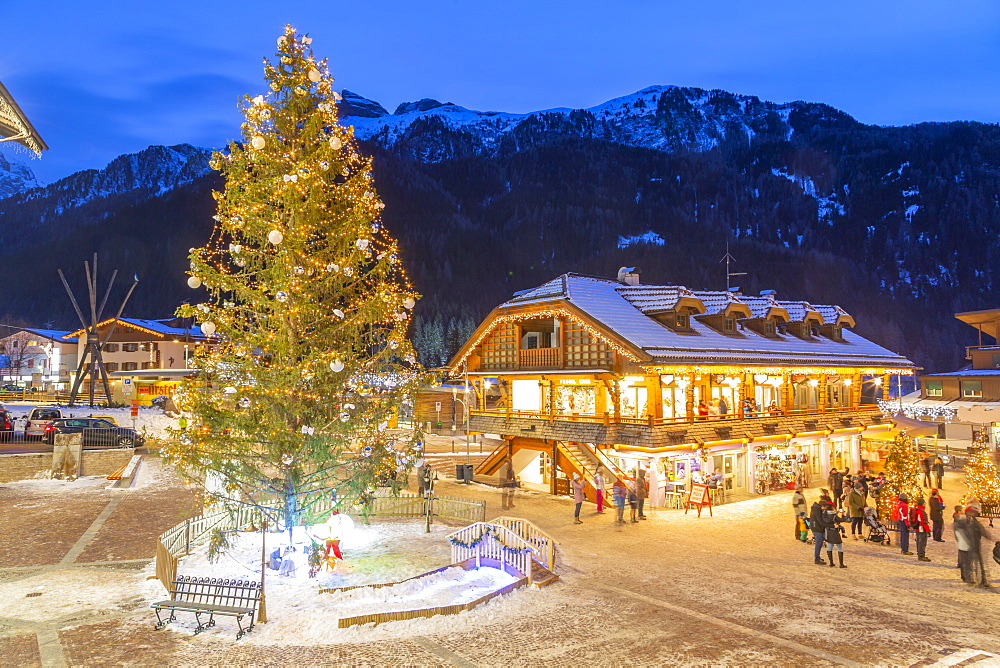 View of Canazei town centre and Christmas tree at dusk, Canazei, Val di Fassa, Trentino, Italy, Europe