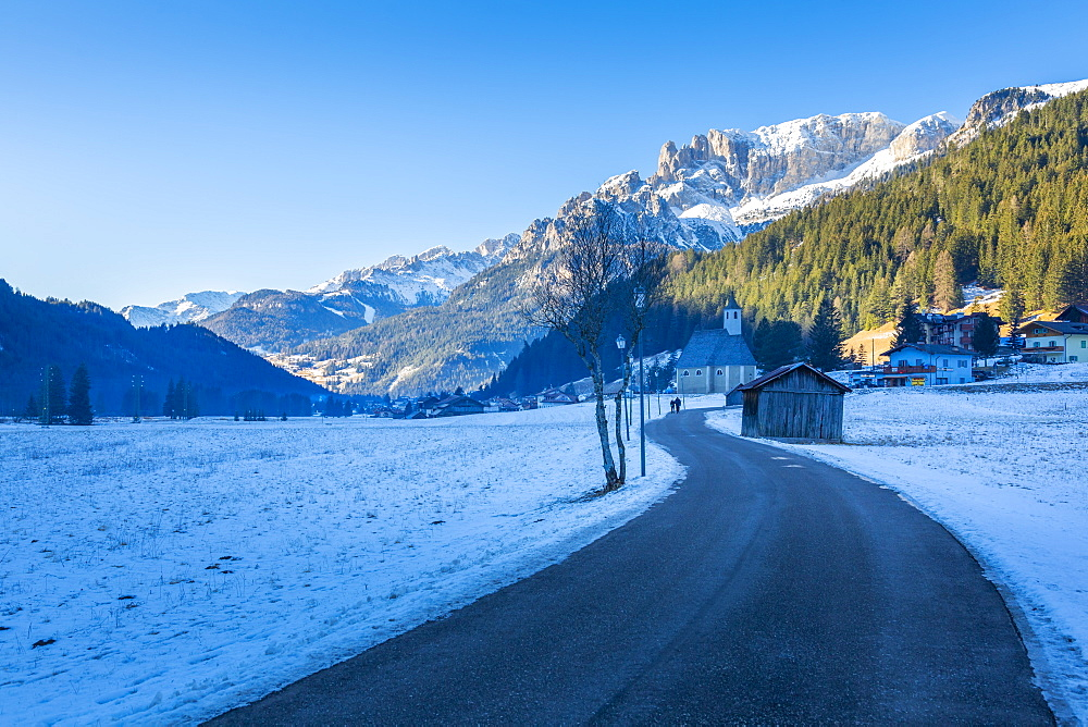 Road through snow under Dolomites Italy, Europe