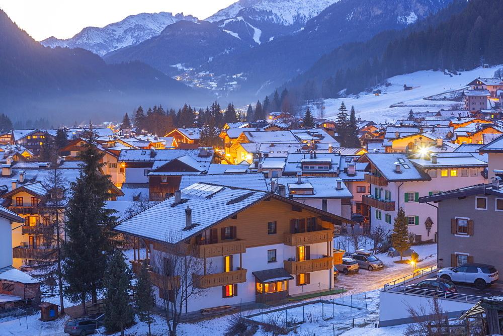 View of Campitello di Fassa at dusk in winter, Val di Fassa, Trentino, Italy, Europe
