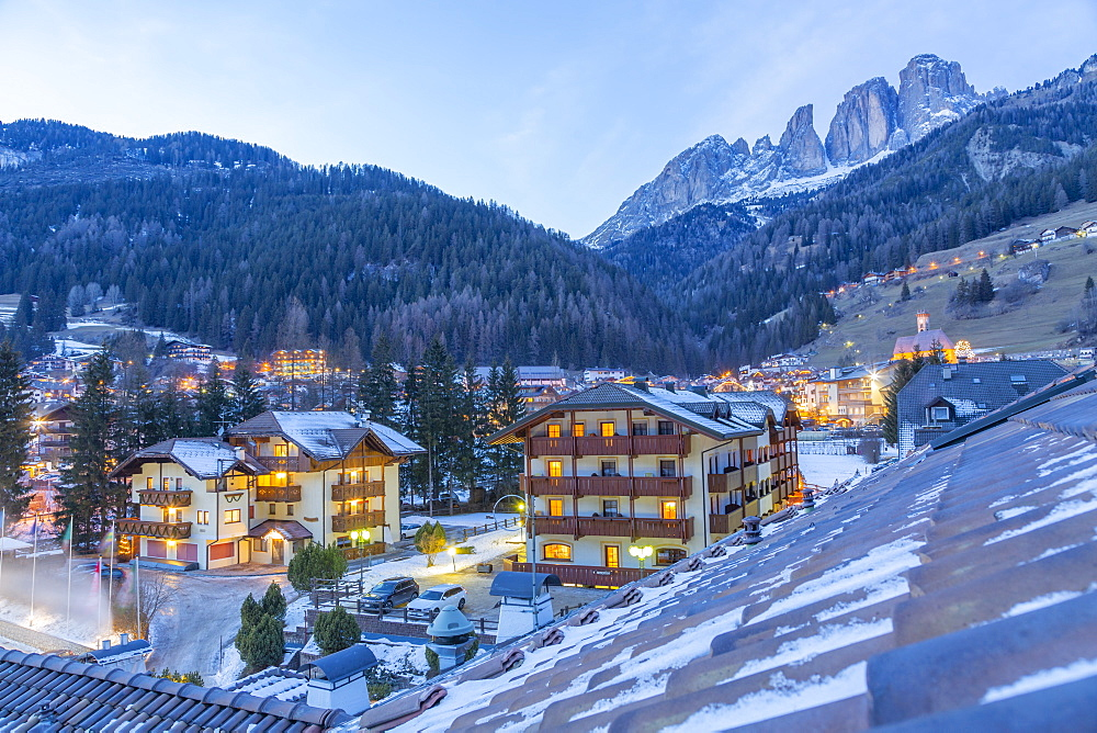 Rooftop view of Campitello di Fassa and GrohmannspitzePunta Grohmann at dusk in winter, Val di Fassa, Trentino, Italy, Europe