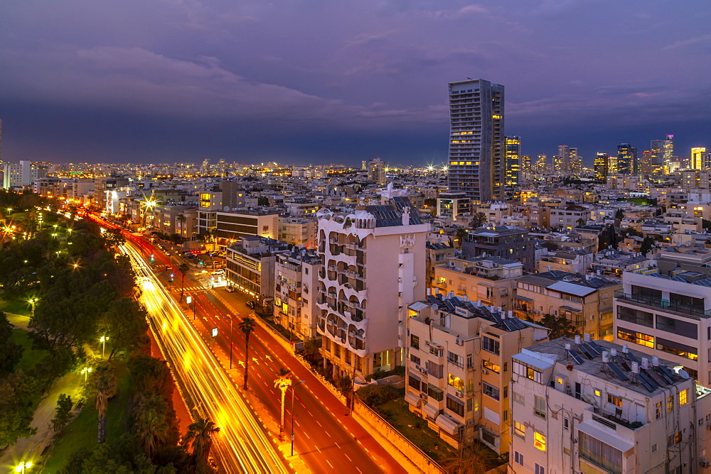 Elevated view of trail lights and Tel Aviv skyline at dusk, Jaffa visible in the background, Tel Aviv, Israel, Middle East