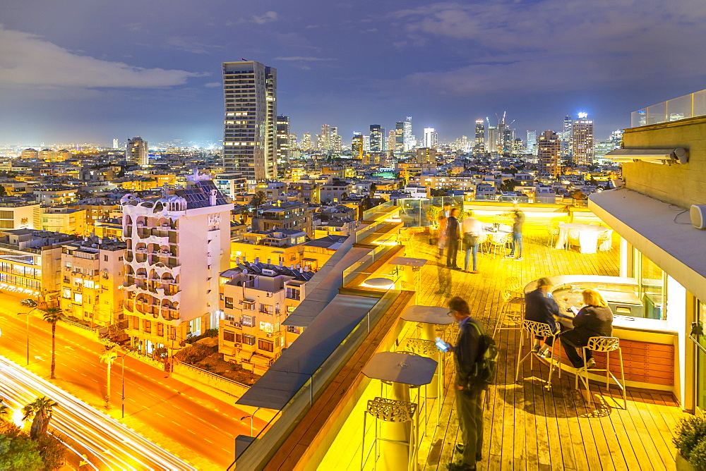 View of hotel rooftop bar and Tel Aviv skyline at dusk, Jaffa visible in the background, Tel Aviv, Israel, Middle East