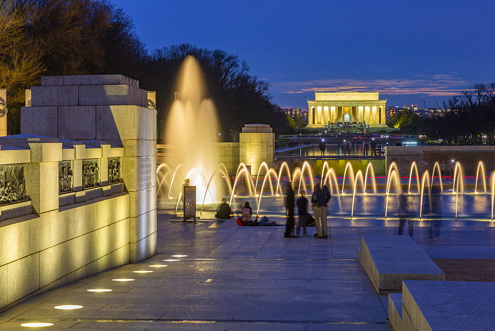 View of the World War Two Memorial and Lincoln Memorial illuminated at dusk, Washington, D.C., United States of America, North America
