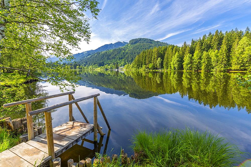 View of reflections in Schwarzsee, Kitzbuhel, Austrian Tyrol, Austria, Europe
