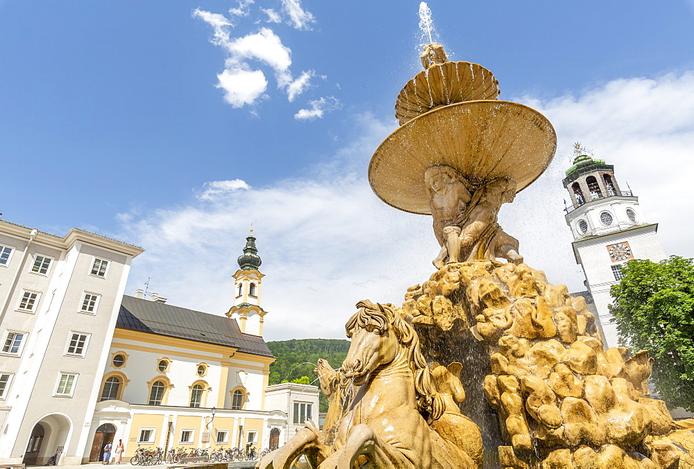 View of Baroque Fountain and Salzburger Glockenspiel in Residenzplatz, Salzburg, Austria, Europe