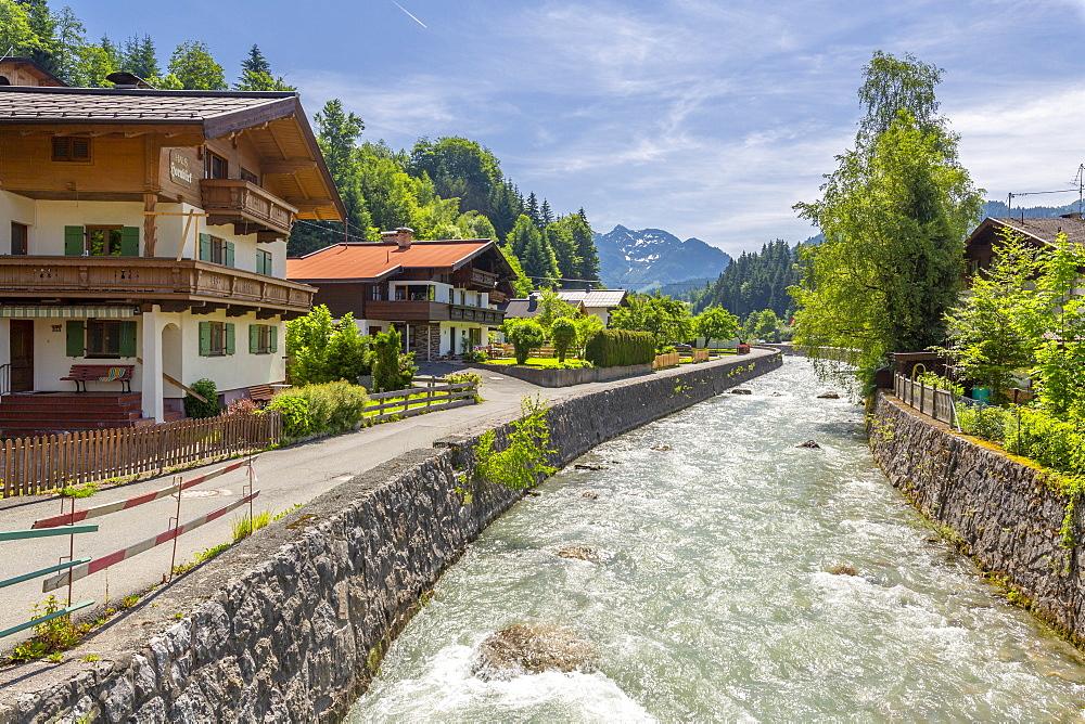 View of river through Fieberbrunn, Fieberbrunn, Austrian Alps, Tyrol, Austria, Europe