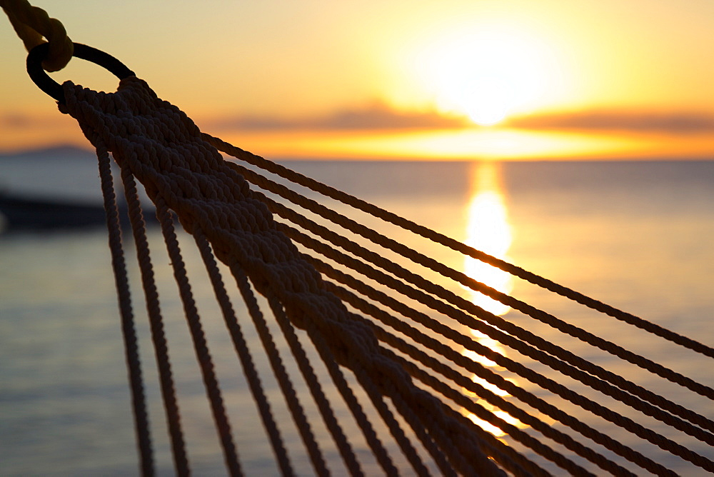 Hammock and beach at sunset, Morris Bay, St. Mary, Antigua, Leeward Islands, West Indies, Caribbean, Central America