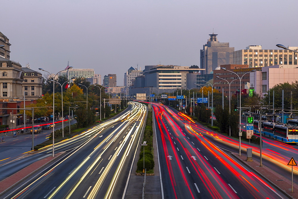 Traffic trail lights on major road near Beijing Zoo at dusk, Beijing, People's Republic of China, Asia - 844-21880