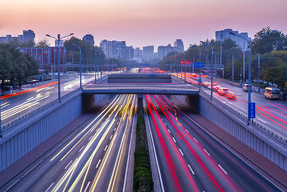Traffic trail lights on major road near Beijing Zoo at dusk, Beijing, People's Republic of China, Asia - 844-21881