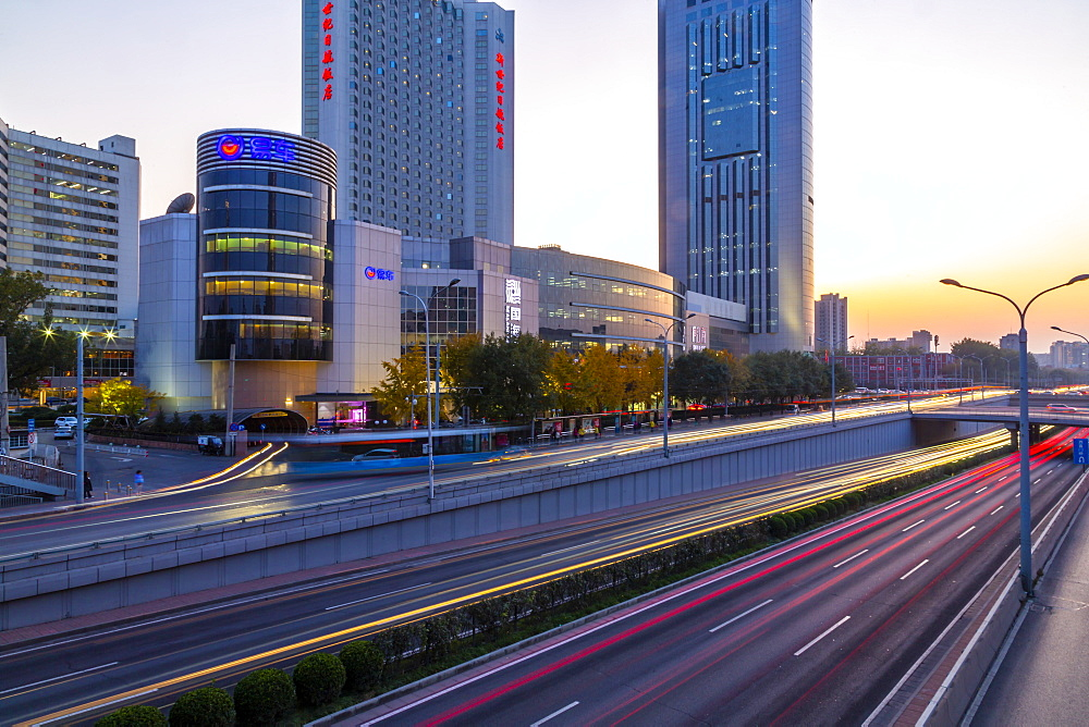 Traffic trail lights on major road near Beijing Zoo at dusk, Beijing, People's Republic of China, Asia - 844-21883
