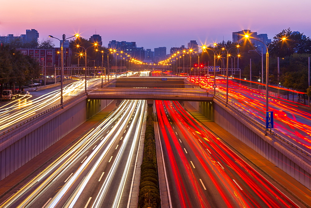 Traffic trail lights on major road near Beijing Zoo at dusk, Beijing, People's Republic of China, Asia - 844-21887