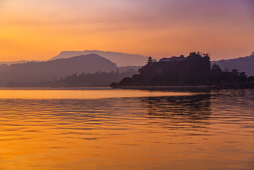 View of Shi Baozhai Pagoda at dusk on Yangtze River near Wanzhou, Chongqing, People's Republic of China, Asia