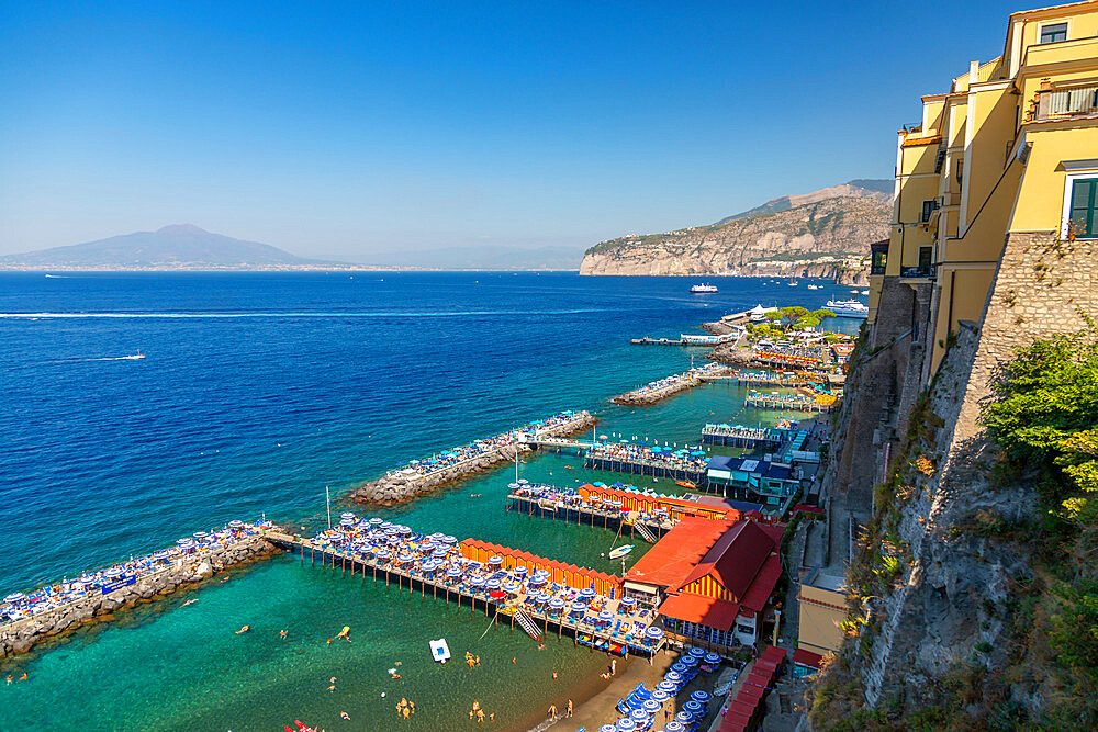 View of Leonelli's beach, public beach and Mount Vesuvius, Sorrento, Campania, Italy, Europe