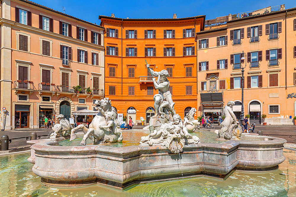 View of the Neptune Fountain and colourful architecture in Piazza Navona, Piazza Navona, Rome, Lazio, Italy, Europe